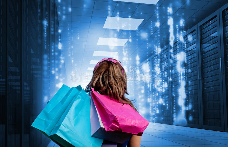 Girl with shopping bags looking at falling matrix royalty free stock photography
