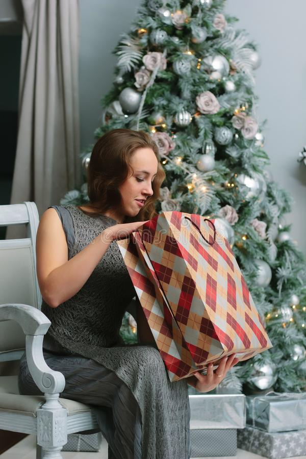 Girl with shopping bags near the christmas tree stock photography