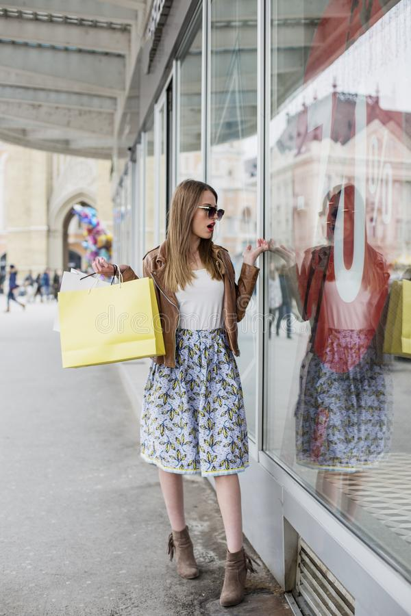 Girl with shopping bags in town royalty free stock photos