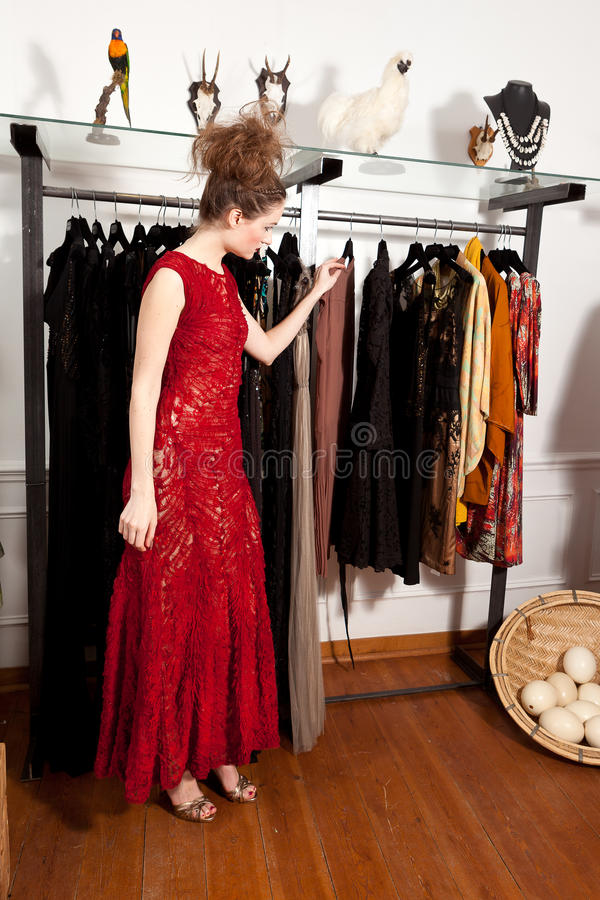 Girl shopping in boutique royalty free stock photography