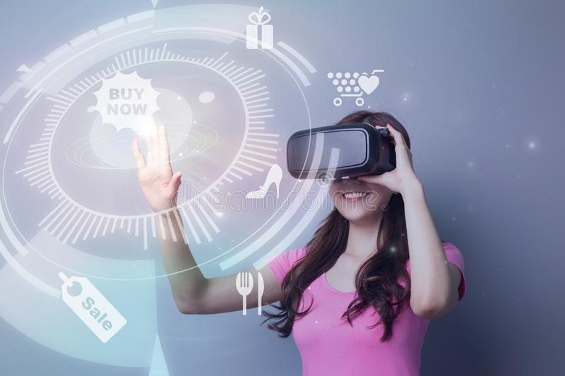 Girl shopping online by VR. Smile asian beauty girl shopping online by VR headset glasses of virtual reality stock photo