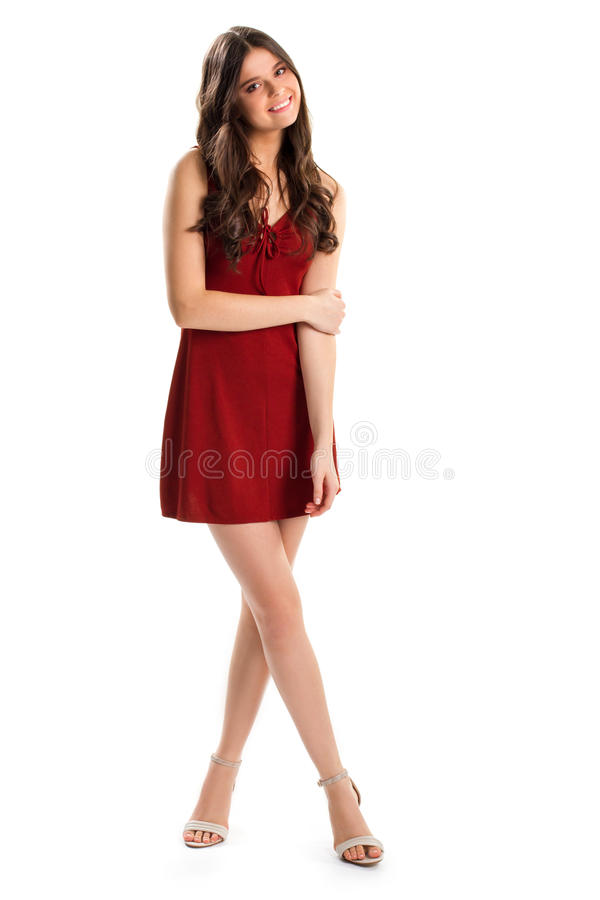 Girl in short red dress. Woman in heels smiles kindly. Cotton dress with keyhole neckline. Modesty and charm stock photography