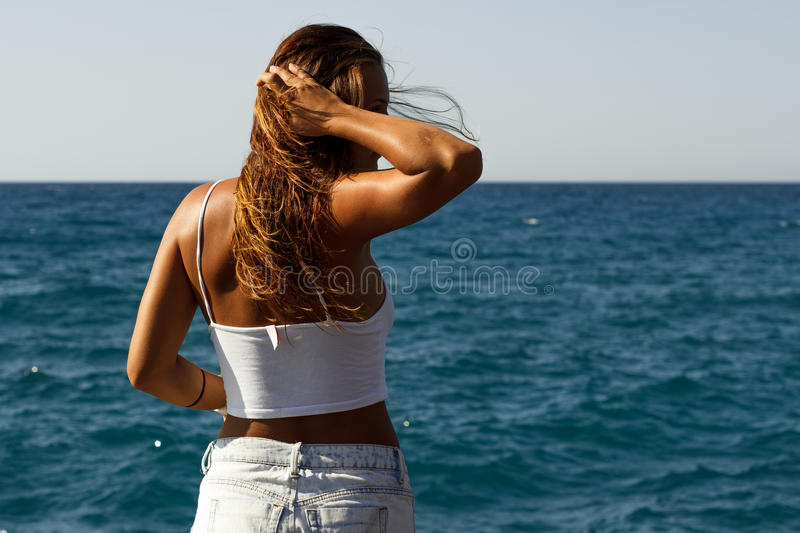 Download Girl In Short Shirt On The Beach Playing With Hair Stock Photo - Image of model, suit: 64449408