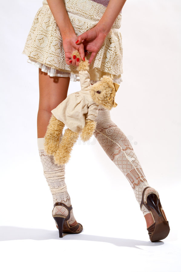 The girl in short skirt royalty free stock photo