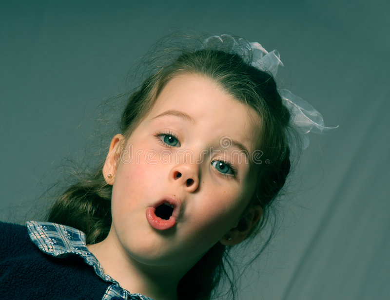 Girl shouting. Little girl singing stock photo