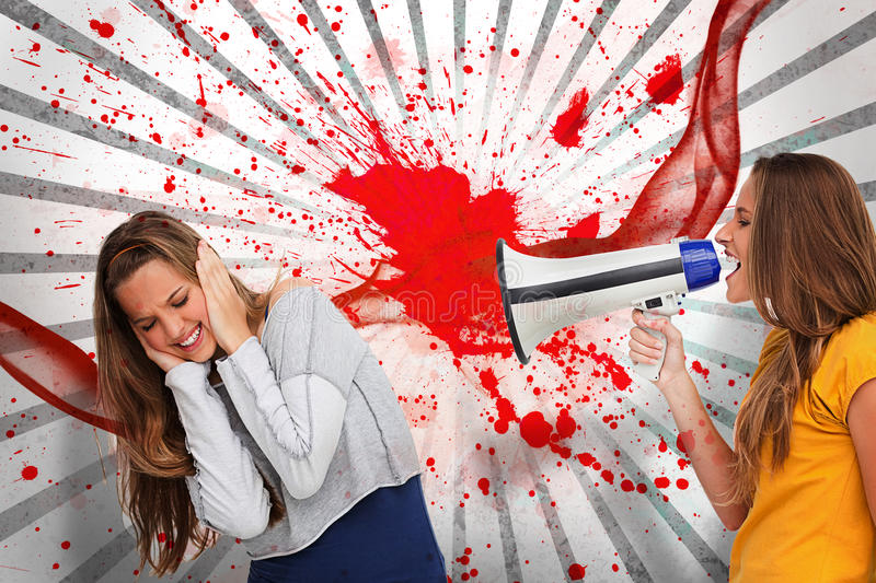 Girl Shouting At Friend Through A Megaphone Stock Image