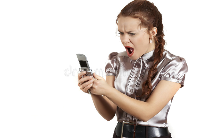 Girl shouts in the telephone. Portrait of the business woman showing of anger and shout royalty free stock photo