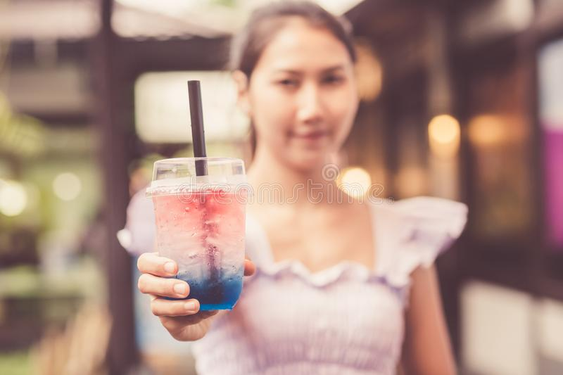 A girl show glass water at the market stock photos