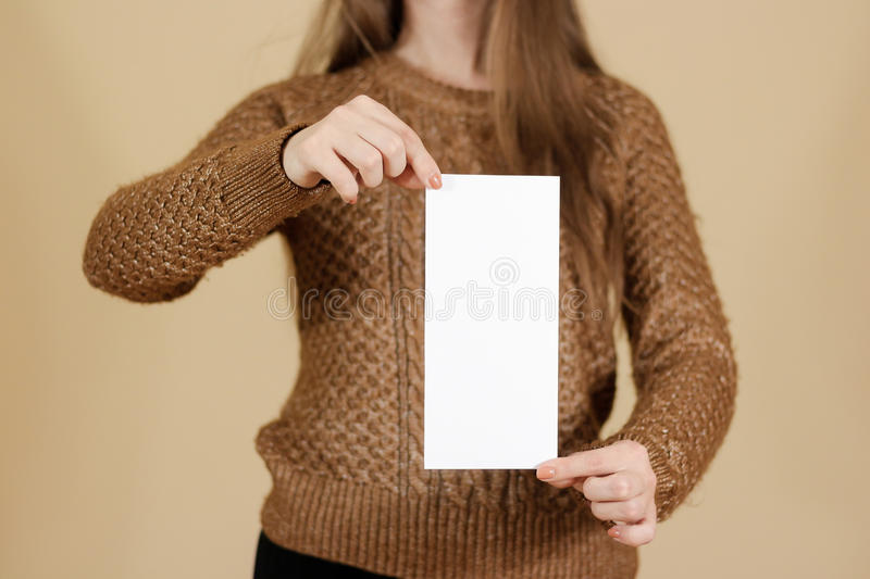 Girl showing blank white flyer brochure booklet. Leaflet present. Ation. Pamphlet hold hands. Woman show clear offset paper. Sheet template. Booklet design sheet stock photos