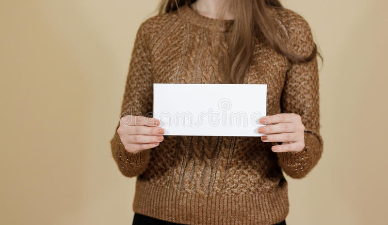 Girl showing blank white flyer brochure booklet. Leaflet present. Ation. Pamphlet hold hands. Woman show clear offset paper. Sheet template. Booklet design sheet stock photography