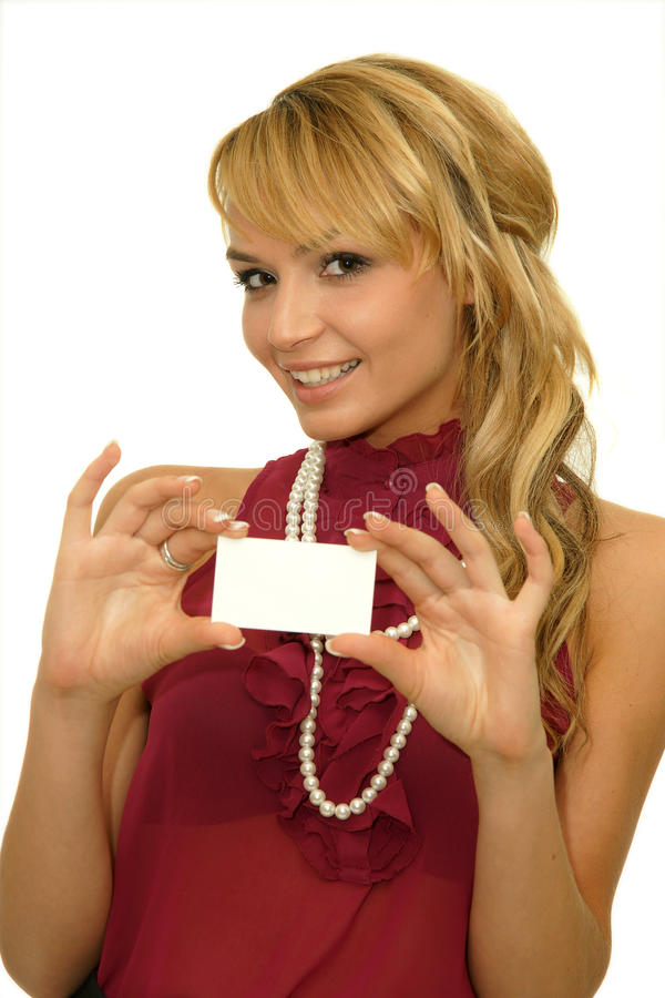 Girl showing business card. Business card or white sign - Portrait of a beautiful girl holding a blank notecard. An attractive young student holding a blank card stock photo