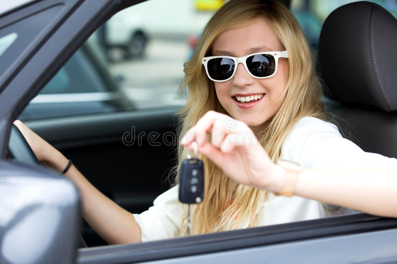 Girl showing car key royalty free stock photography
