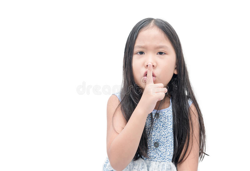 Girl showing hand quiet silence sign gesture royalty free stock image