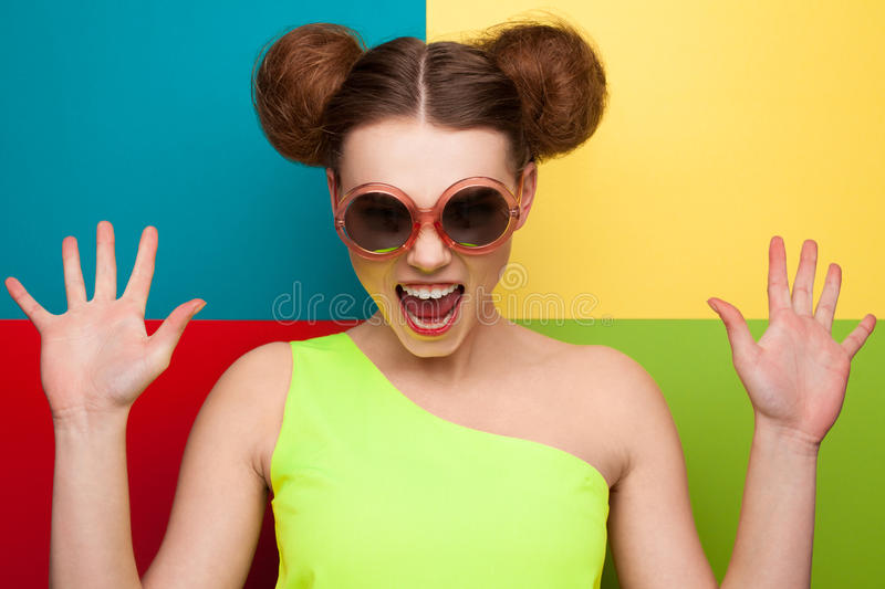 Girl showing hands on colourful background stock images