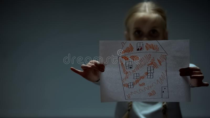 Girl showing house picture into camera, orphan child needs home and family stock photos