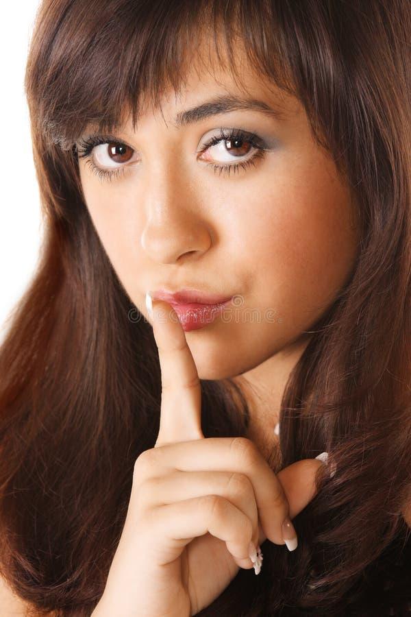 Girl showing hush gesture stock image