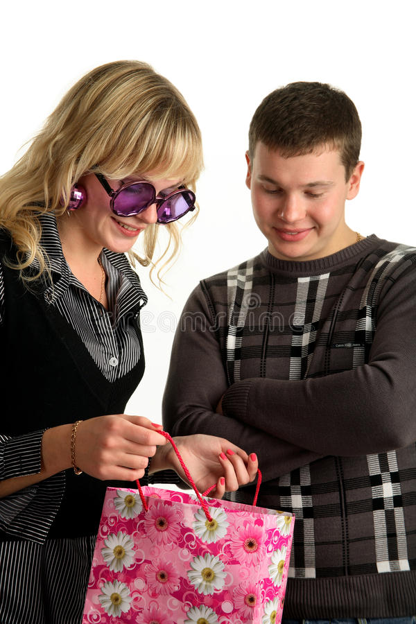 Download The Girl Is Showing Package Shopping To Her Boyfri Stock Image - Image: 12241311