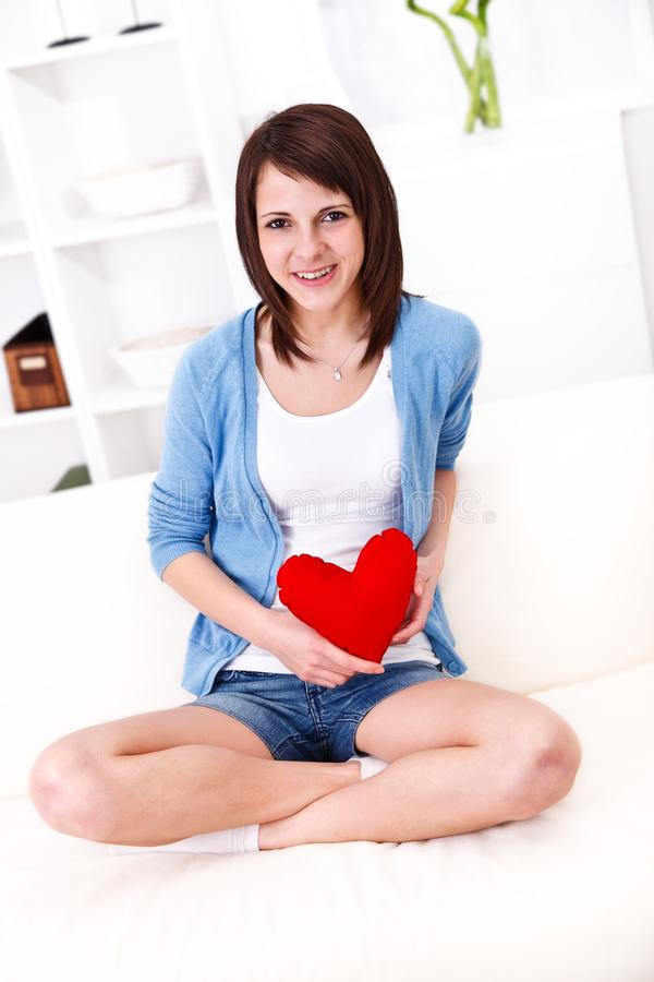 Girl showing red heart royalty free stock image