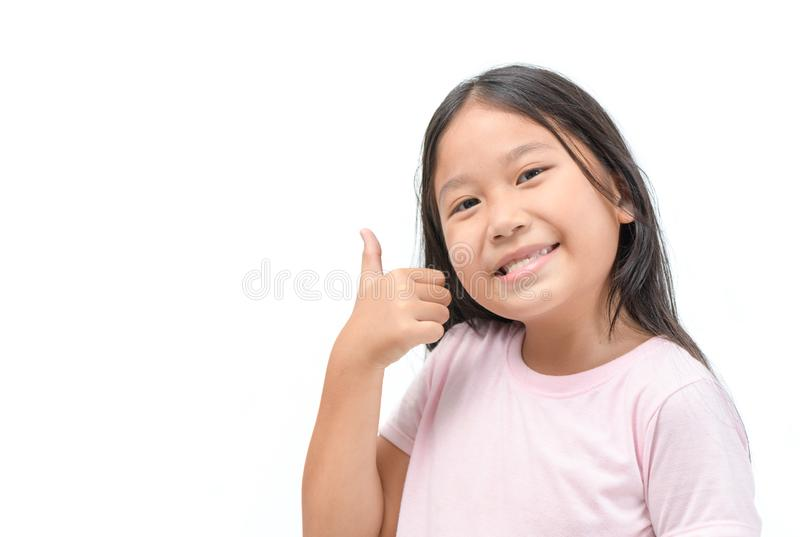 Girl showing thumbs up gesture isolated stock photography