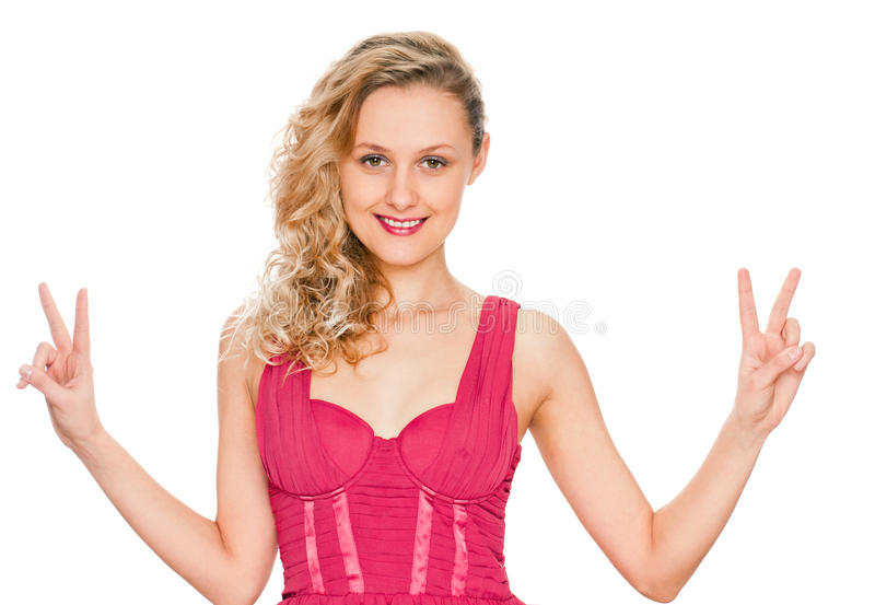Girl showing victory sign royalty free stock photo