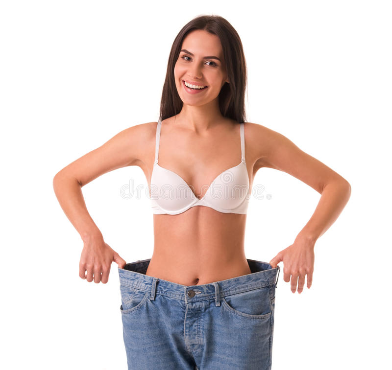 Girl showing weight loss royalty free stock photography
