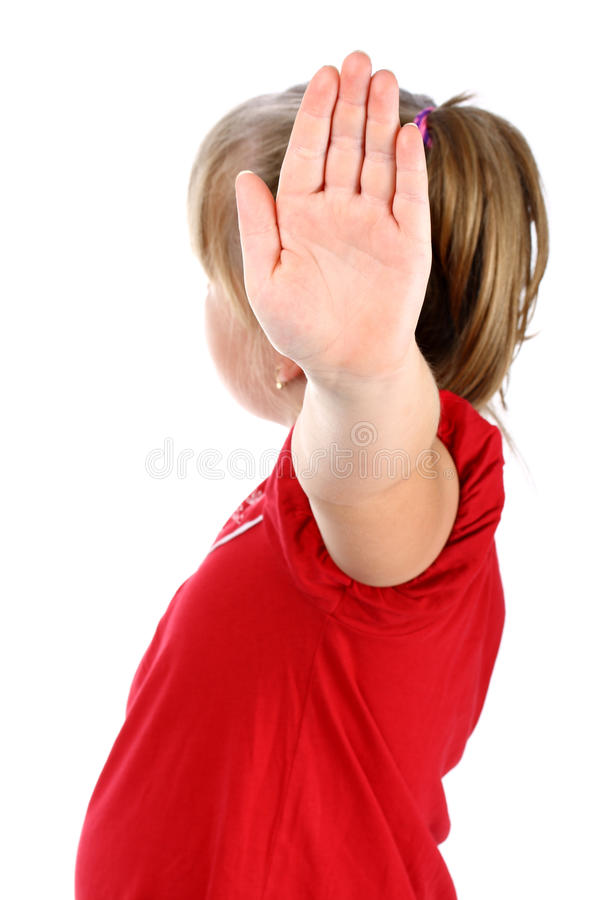 Girl shows denial with her hand isolated on white stock image
