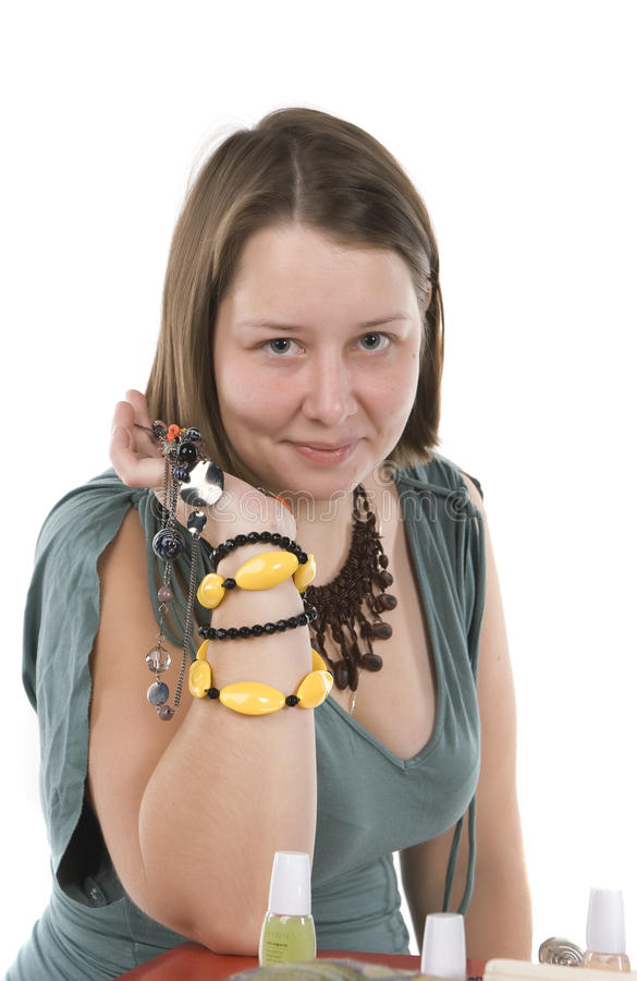Girl shows ornaments stock photography