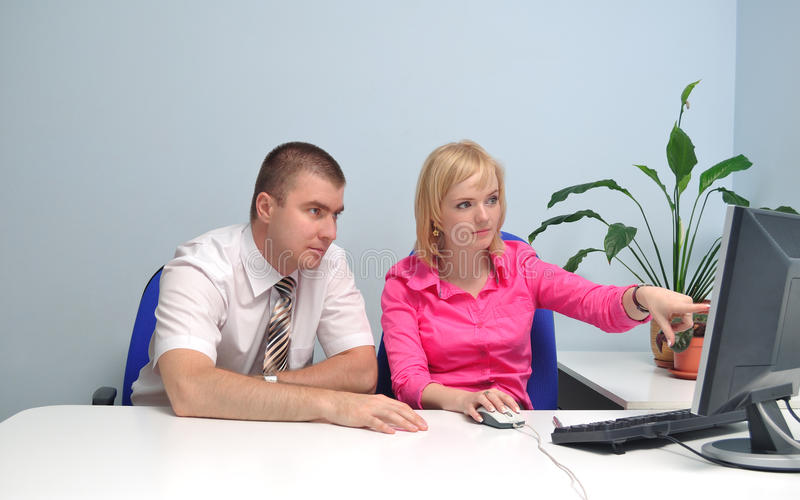 Girl Shows Something On The Monitor To A Colleague Stock Photography