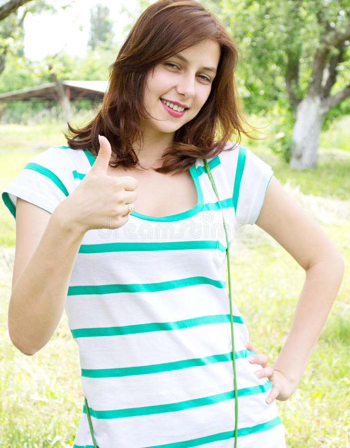 Download Girl shows the thumb stock photo. Image of face, beauty - 25589362