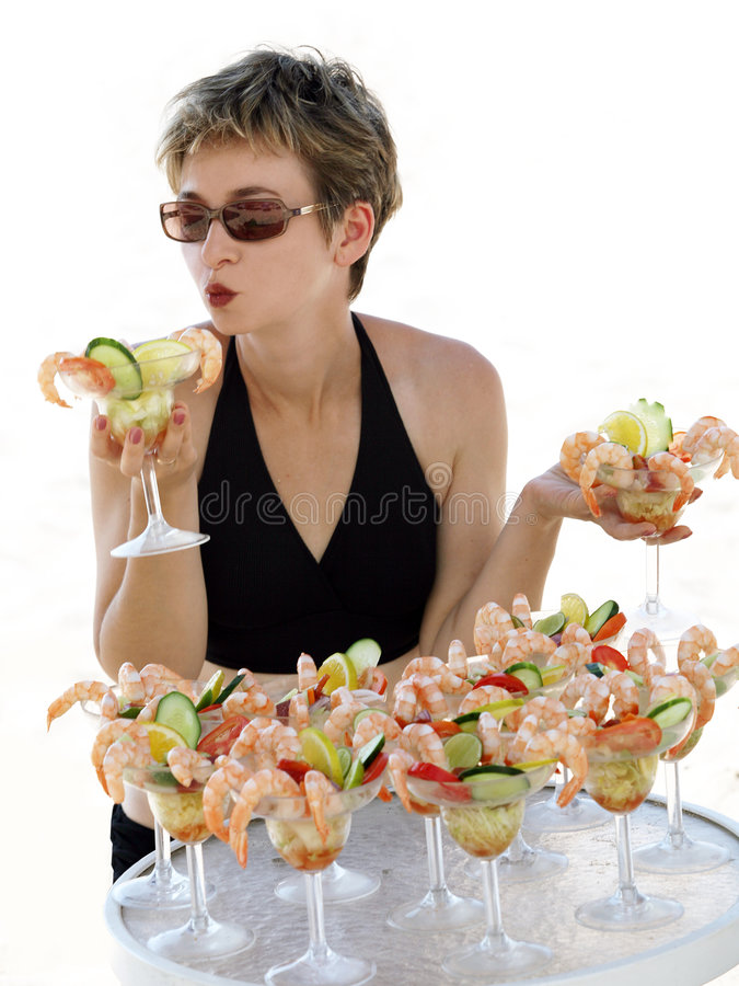 Girl with shrimp cocktail stock photo