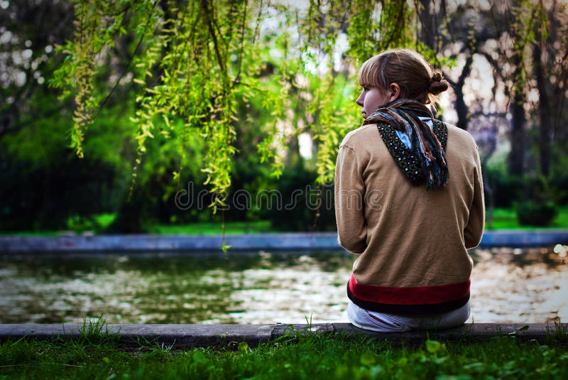 Girl On The Side Of The River Stock Image
