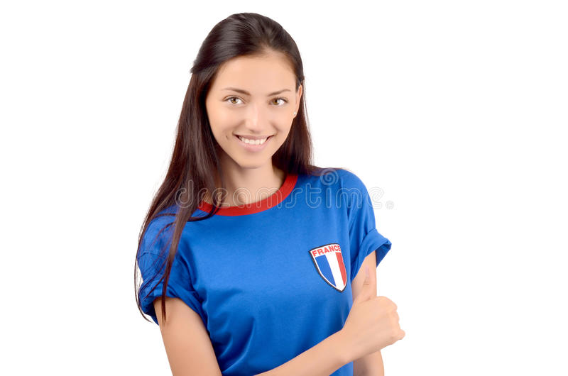Girl signing thumbs up for France. stock photo