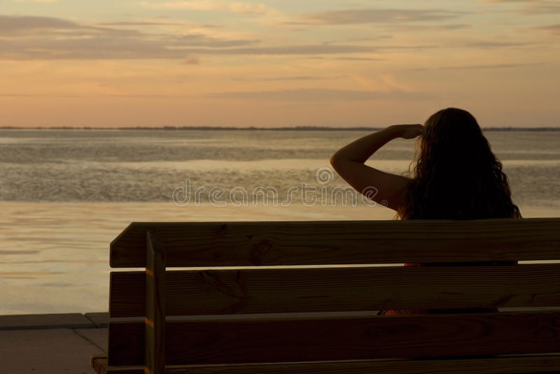 Download Girl In Silhouette Looking At Sunset Stock Photo - Image: 24470166