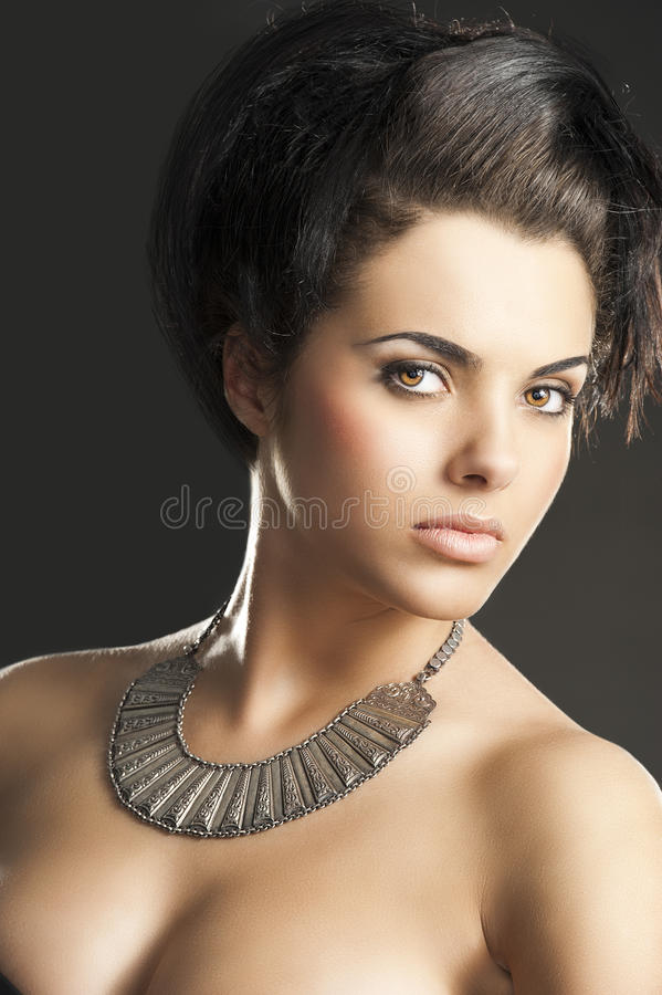 The girl with silver necklace, she looks at right stock photo