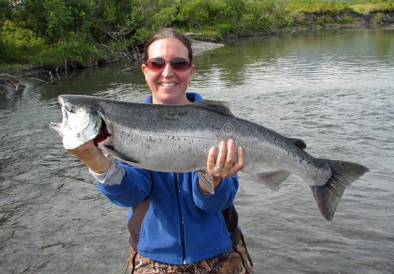 Girl with silver salmon stock images