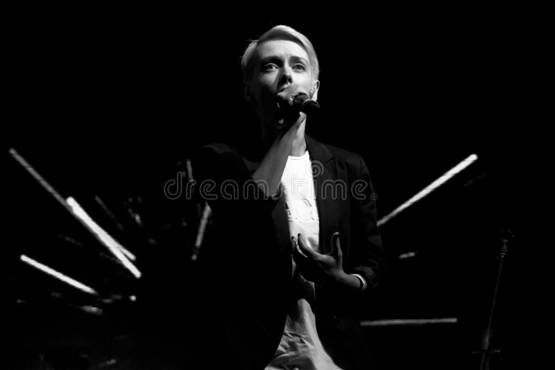 Girl singer with short blonde hair sings at a rock concert. Black and white photo stock photography