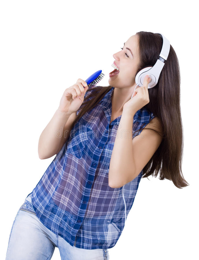 Girl singing into a hairbrush isolate stock images