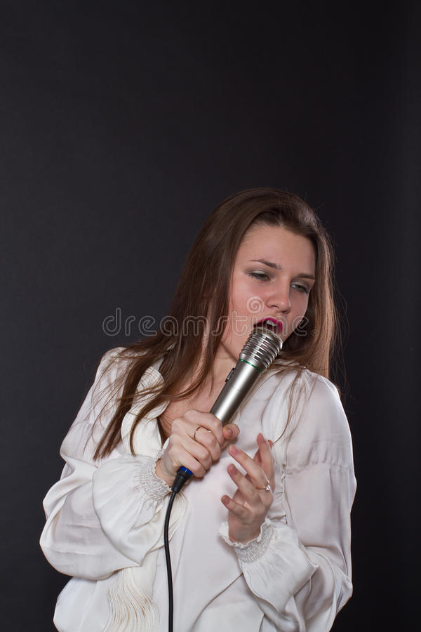 Girl singing into a microphone