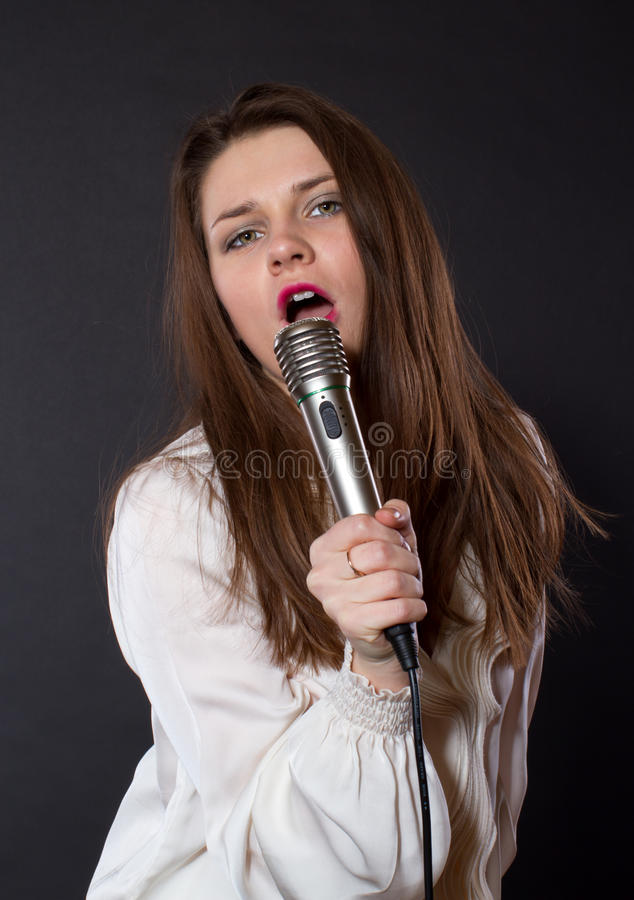 Download Girl Singing Into A Microphone Stock Photo - Image: 28845058