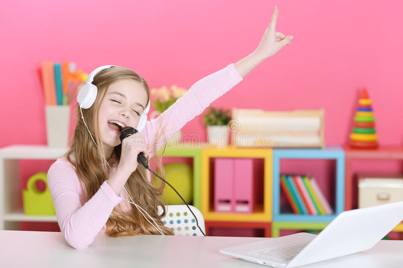 The girl singing into a microphone royalty free stock photos