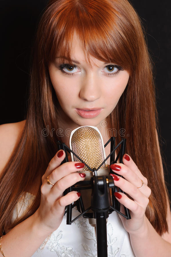 Singing Girl In Headphones. Royalty Free Stock Images