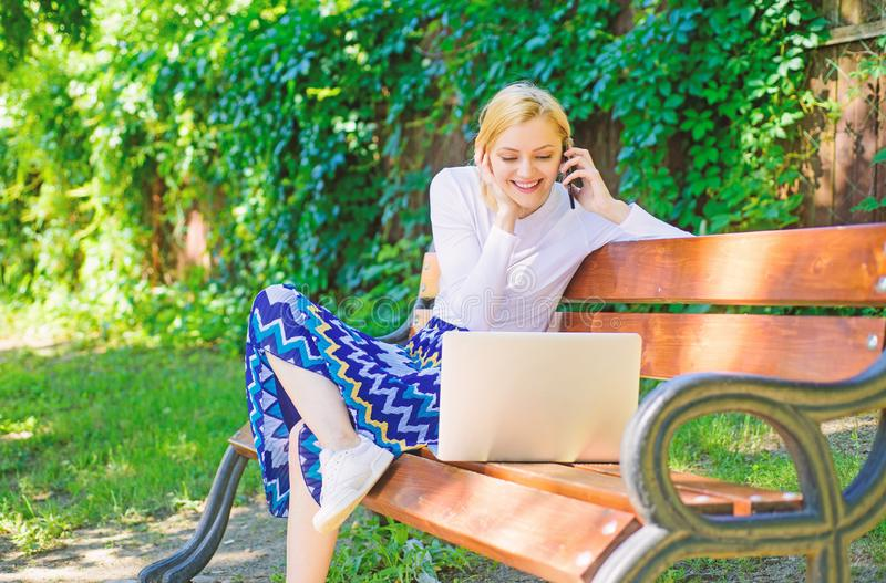 Girl sit bench with notebook call phone. Save your time with shopping online. Shopping online. Woman laptop in park. Enjoy green nature and fresh air. Girl royalty free stock photos