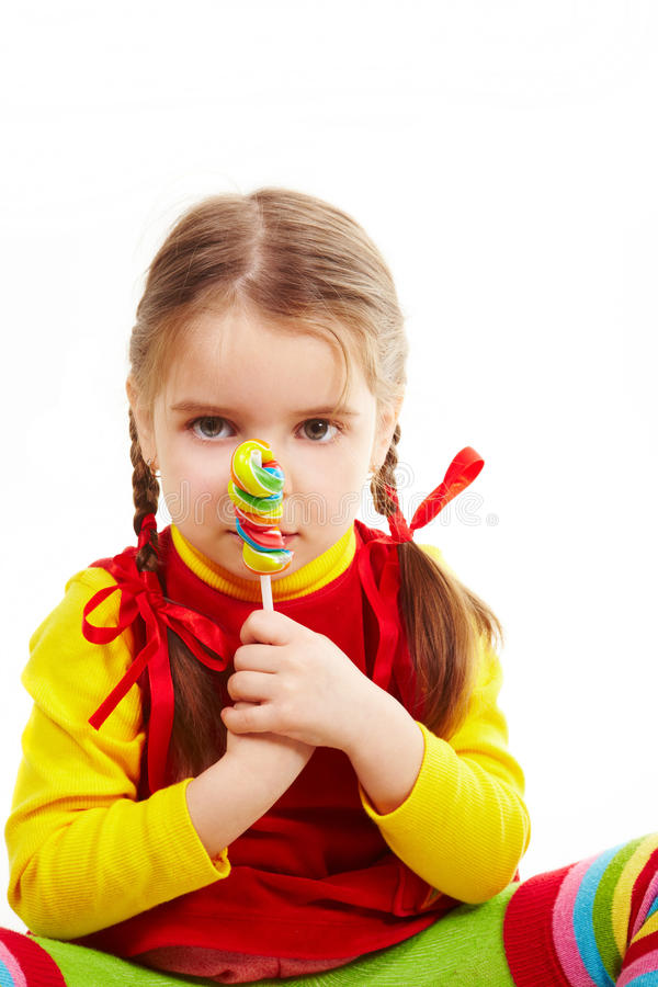 Girl sit with candy 2 royalty free stock photo