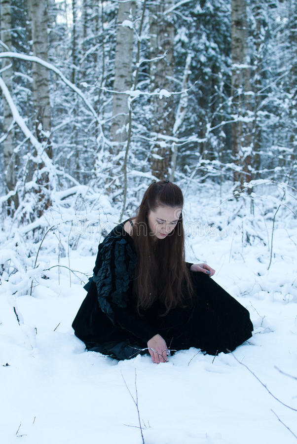 Girl Sit In Winter Forest Royalty Free Stock Photography