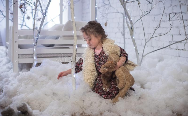 The girl sits in artificial snow stock photos