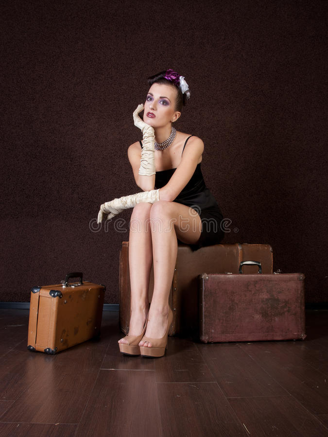 Download Girl sits on a bag stock image. Image of suitcase, studio - 22583421