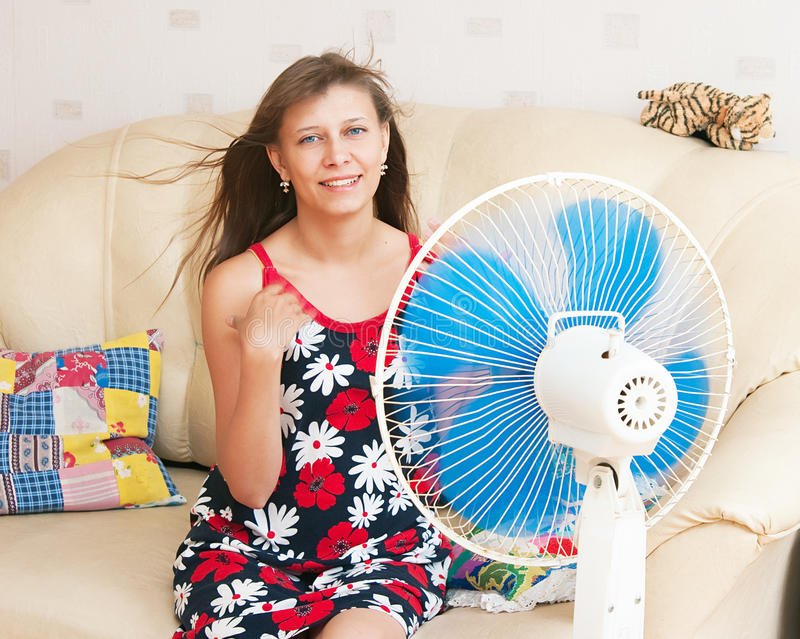 Download The Girl Sits In Front Of The Fan Stock Image - Image: 17308465