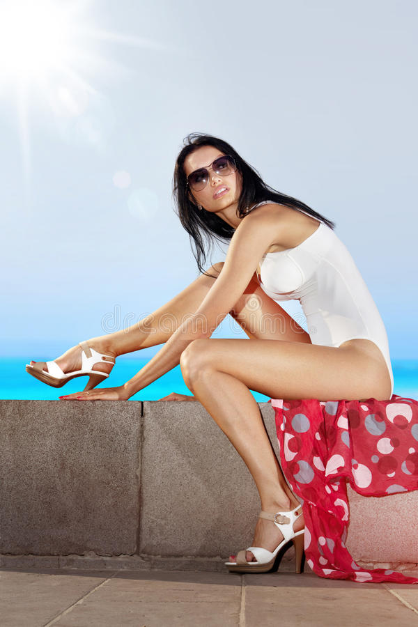 Download Girl Sits On Quay Royalty Free Stock Images - Image: 32148249