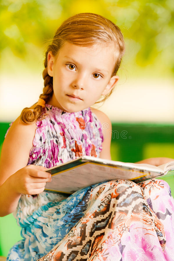 Girl Sits Reading Book Stock Images