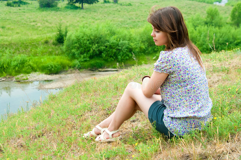 Download The girl sits on the rock stock photo. Image of rock - 29106858